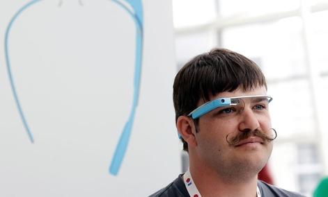 Engineer Ian McKellar wears a pair of Google Glass at a booth at Google I/O 2013 in San Francisco.