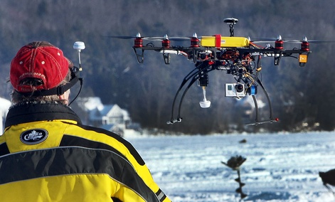 "Steve Capachietti pilots his drone with video camera attached on the bottom while taking video at the ""Great Rotary Fishing Derby"" on Lake Winnipesaukee, N.H."