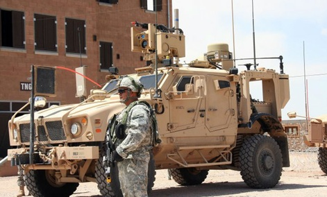 A Soldier from 2nd Brigade, 1st Armored Division, stands before a Warfighter Information Network-Tactical Increment 2 Point of Presence in May 2012.