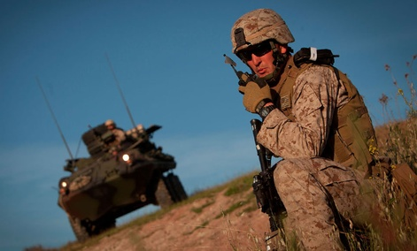 Marine Corps Staff Sgt. Brian Sears relays an update to his platoon commander during an exercise at Camp Pendleton, Calif.