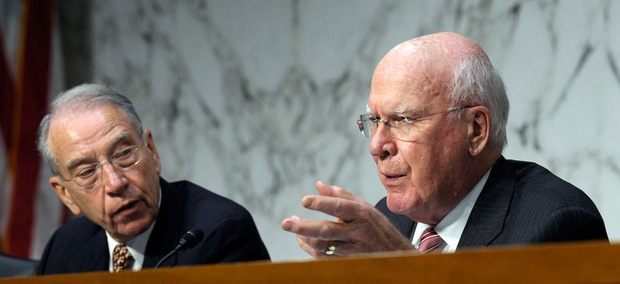 Senate Judiciary Committee Chairman Sen. Patrick Leahy, D-Vt., left, accompanied by the committee's ranking Republican Sen. Charles Grassley, R-Iowa.