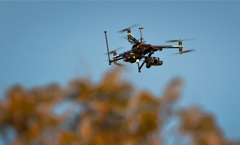 A drone fitted with a camera flies in South Africa.