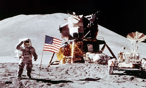 Apollo 15 Lunar Module Pilot James B. Irwin salutes while standing beside the fourth American flag planted on the surface of the moon, July 30, 1971.