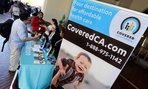 An information table advertising California's health care exchange sits in downtown Los Angeles in January.