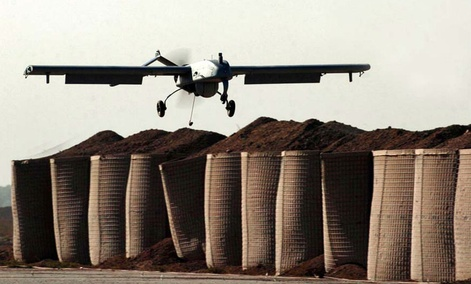 "An unmanned drone RQ-7A ""Shadow"" lands at an American military base in Baqouba, Iraq."