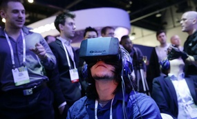 Attendees play a video game wearing Oculus Rift virtual reality headsets at the Intel booth at the International Consumer Electronics Show in Las Vegas.