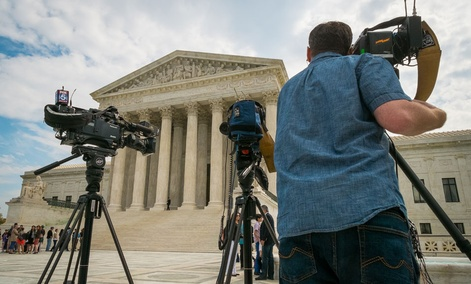 Videojournalists set up outside of the U.S. Supreme Court in Washington, Tuesday, April 22, 2104.