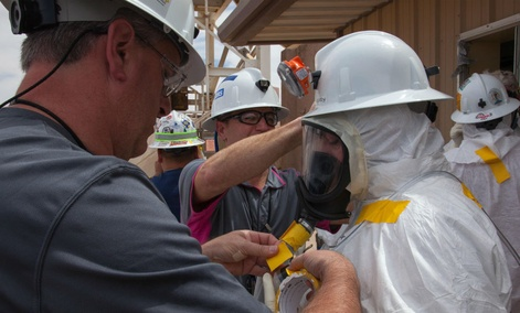 Workers preparing to enter the Waste Isolation Pilot Plant facility in Carlsbad, N.M., for the first time since the February 14 radiological release.