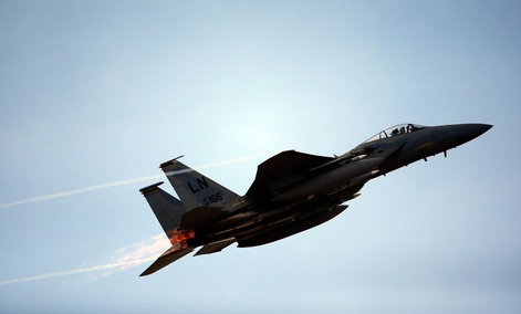 A U.S military jet flies over Vilnius during the Lithuanian