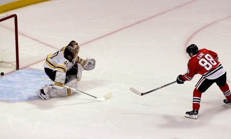 Chicago Blackhawk forward Patrick Kane scores against Boston Bruins goalie Tuukka Rask in a January game.
