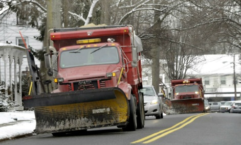Snow plows drive down the clear streets in Allentown, N.J., Monday, March 17, 2014.