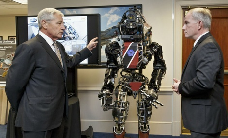 Defense Secretary Chuck Hagel gets a look at one of the latest robotics projects from DARPA