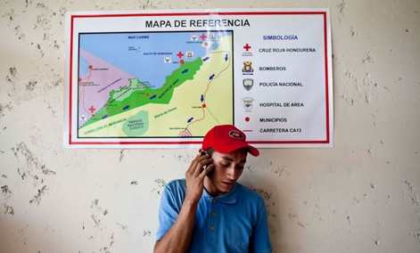 A man talks on a cell phone in Corinto, Honduras, near the border with Guatemala.
