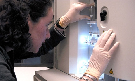 A researcher monitors a DNA sequencing machine at the NIH in Bethesda, Md.