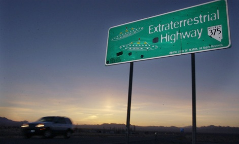 A car moves along the Extraterrestrial Highway near Rachel, Nevada, and along the border of Area 51.