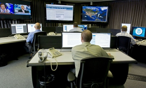 "Cyber security analysts work in the ""watch and warning center"" at DHS' cyber defense lab."