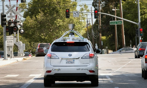 A Google driverless car navigating along a street in Mountain View, California.