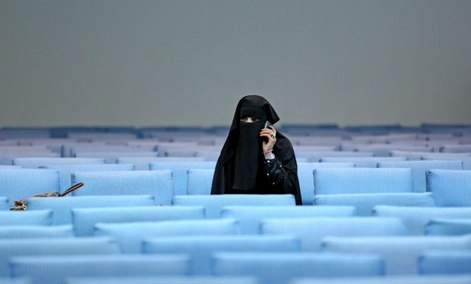 A female supporter of Afghan presidential candidate Ashraf Ghani Ahmadzai talks on the phone after a campaign rally for women in Kabul.
