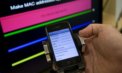 A cell phone displays information during a Federal Trade Commission mobile tracking demonstration.