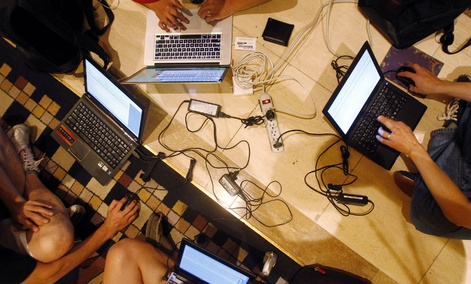 Hackers participate in a competition at the DefCon conference Friday, Aug. 5, 2011.