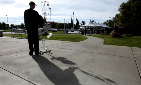 Michael Bruce, a patient at the Sacramento Veterans Affairs Medical Center, watches a Veterans Day ceremony held at the center in Rancho Cordova, Calif.