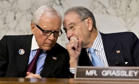 Sen. Orrin Hatch, R-Utah, ranking Republican on the Senate Finance Committee, left, talks with Sen. Chuck Grassley, R-Iowa