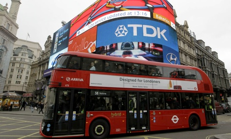 A double decker bus passes Piccadilly Circus in London.