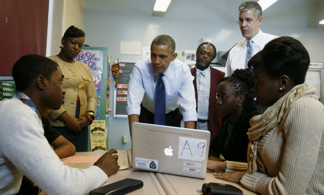 President Barack Obama, accompanied by Education Secretary Arne Duncan, right, visits a math classroom at Pathways in Technology Early College High School (P-TECH) in Brooklyn, New York.