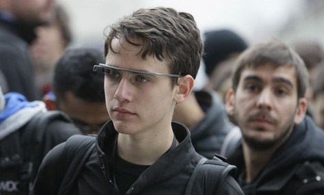 An Apple Worldwide Developers Conference attendee wears Google Glass in San Francisco.