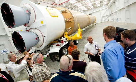 NASA Administrator Charles Bolden, stands in front of the ULA-made Atlas V first stage booster while taking questions from the media