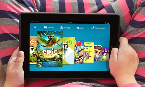 A child plays on a Kindle Fire tablet.