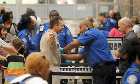 Airline passengers go through the Transportation Security Administration security checkpoint at Hartsfield-Jackson Atlanta International Airport.
