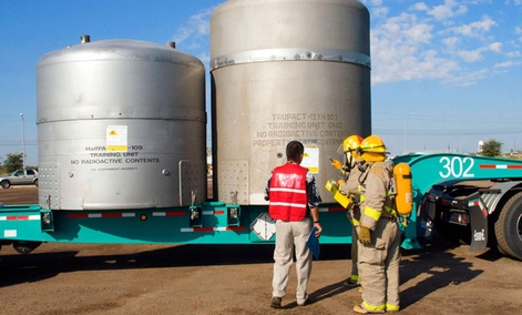 Firefighters practice responding to a simulated incident involving a WIPP shipment during an exercise.
