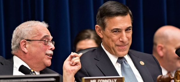 House Oversight Committee Chairman Darrell Issa, R-Calif., right, reacts to Rep. Gerry Connolly, D-Va.