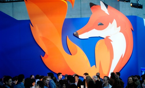 People gather in the Firefox booth at the Mobile World Congress, the world's largest mobile phone trade show in Barcelona, Spain.