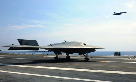 The Navy's unmanned X-47B lands aboard the aircraft carrier USS Theodore Roosevelt.