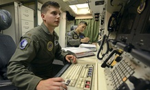 2nd Lt. Oliver Parsons, left, and 1st Lt. Andy Parthum check systems in the underground control room at an ICBM launch control facility near Minot, N.D., in June.