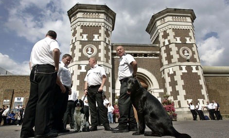 Staff strike outside the main gate of the Wormwood Scrubs prison in west London.