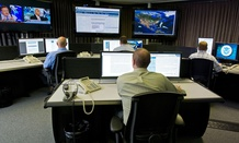 "Cyber security analysts work in the ""watch and warning center"" during the first tour of the government's secretive cyber defense lab, in Idaho Falls, Idaho."