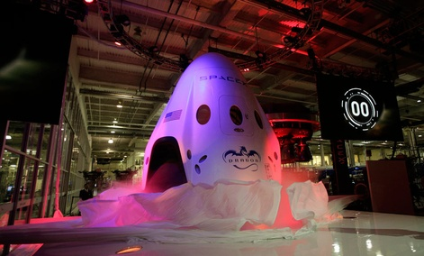 The SpaceX Dragon V2 spaceship is unveiled at its headquarters on Thursday, May 29, 2014.