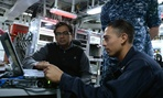 A member of Operation Trident Warrior shows sailors how to use a Malicious Activity Security Tool.