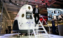 Elon Musk, CEO and CTO of SpaceX, walks down the steps while introducing the SpaceX Dragon V2 spaceship.