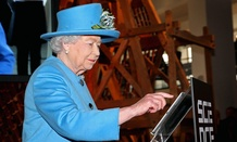 Queen Elizabeth II sends her first Tweet during a visit to the Information Age Exhibition at the London Science Museum.