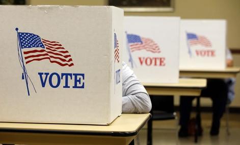 A local resident marks her ballot at Michael J. Manatt Community Center Tuesday, Nov. 4, 2014, in Brooklyn, Iowa.