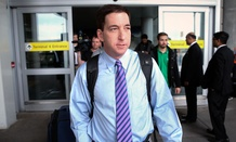 Journalist Glenn Greenwald steps out of Terminal 4 after arriving at John F. Kennedy International Airport Friday, April 11, 2014, in New York.