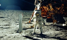NASA astronaut Buzz Aldrin stands beside solar wind experiment on the moon.