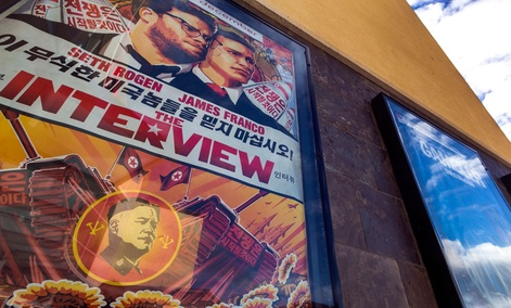 """A movie poster for the movie """"The Interview"""" is displayed outside the AMC Glendora 12 movie theater Wednesday, Dec. 17, 2014, in Glendora, Calif."""