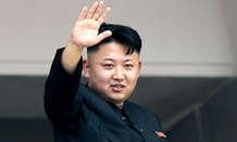 North Korean leader Kim Jong Un waves to spectators and participants of a mass military parade celebrating the 60th anniversary of the Korean War armistice in Pyongyang, North Korea.