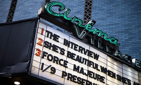 """""""The Interview"""" is listed on the Cinema Village movie theater marquee, Thursday, Dec. 25, 2014, in New York."""