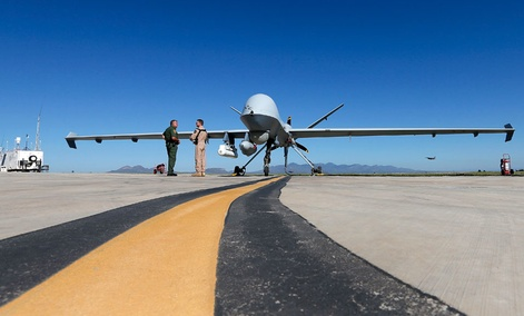 Lothar Eckardt, right, executive director of National Air Security Operations at U.S. Customs and Border Protection, speaks with a Customs and Border Patrol agent prior to a drone aircraft flight.